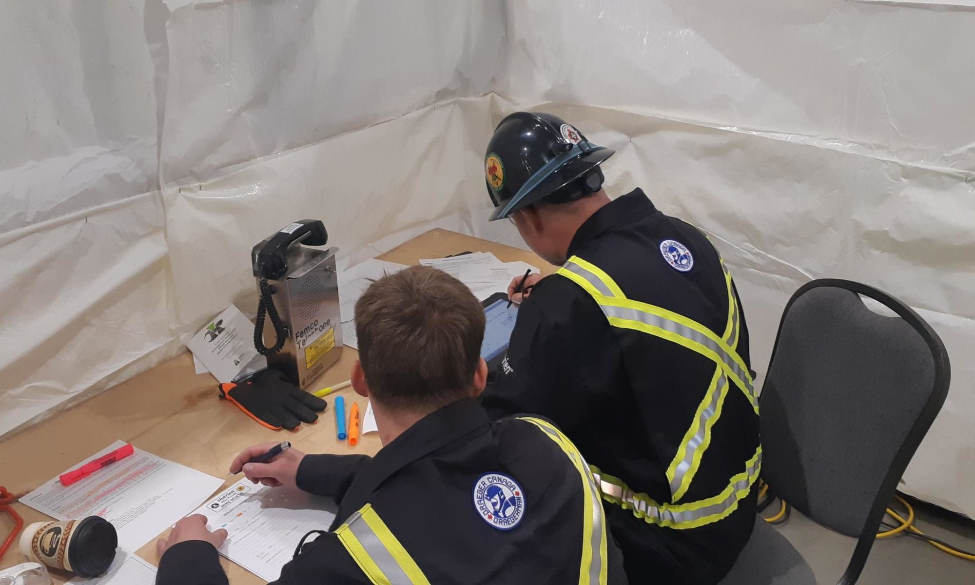 Team members using mine rescue software on a tablet