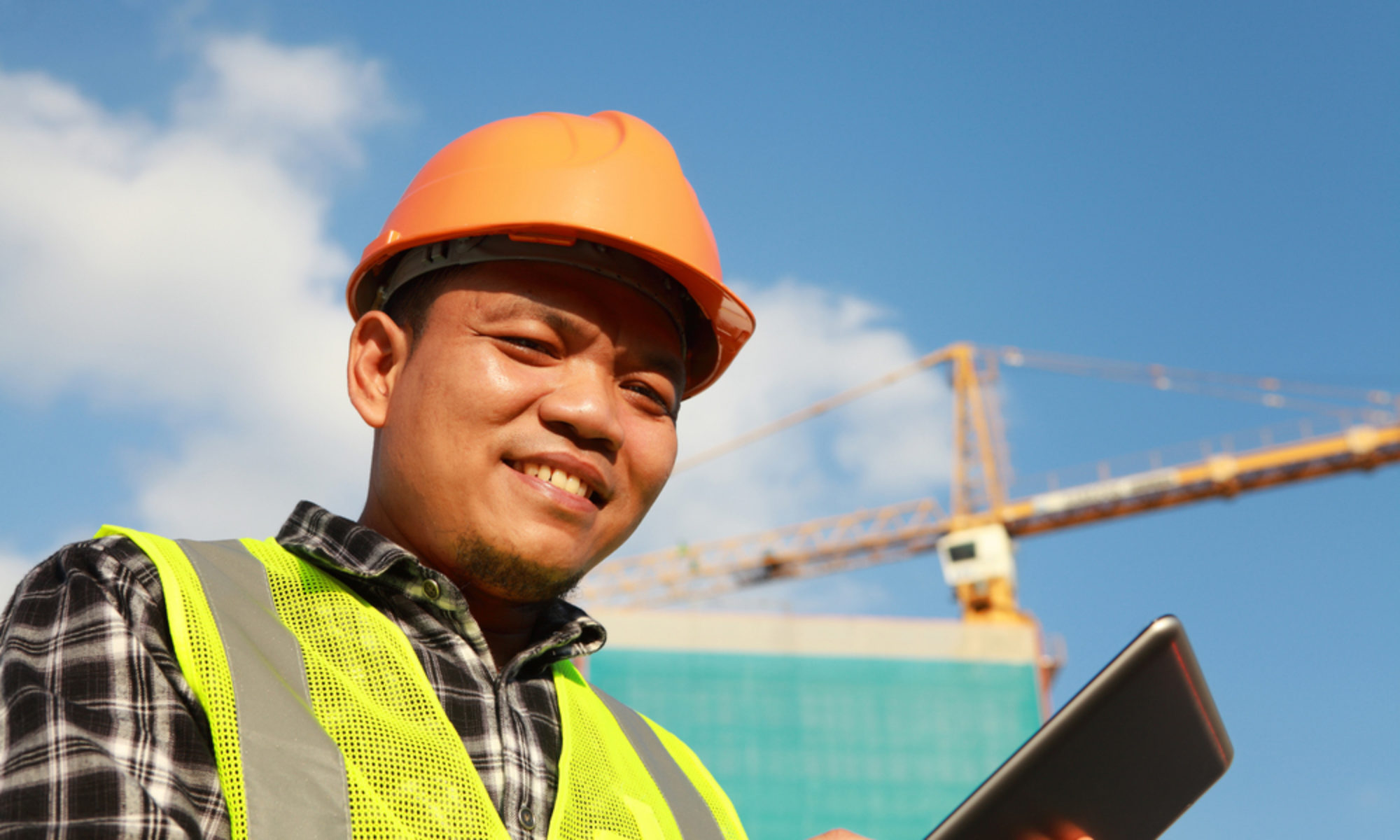 Contruction site worker smiling