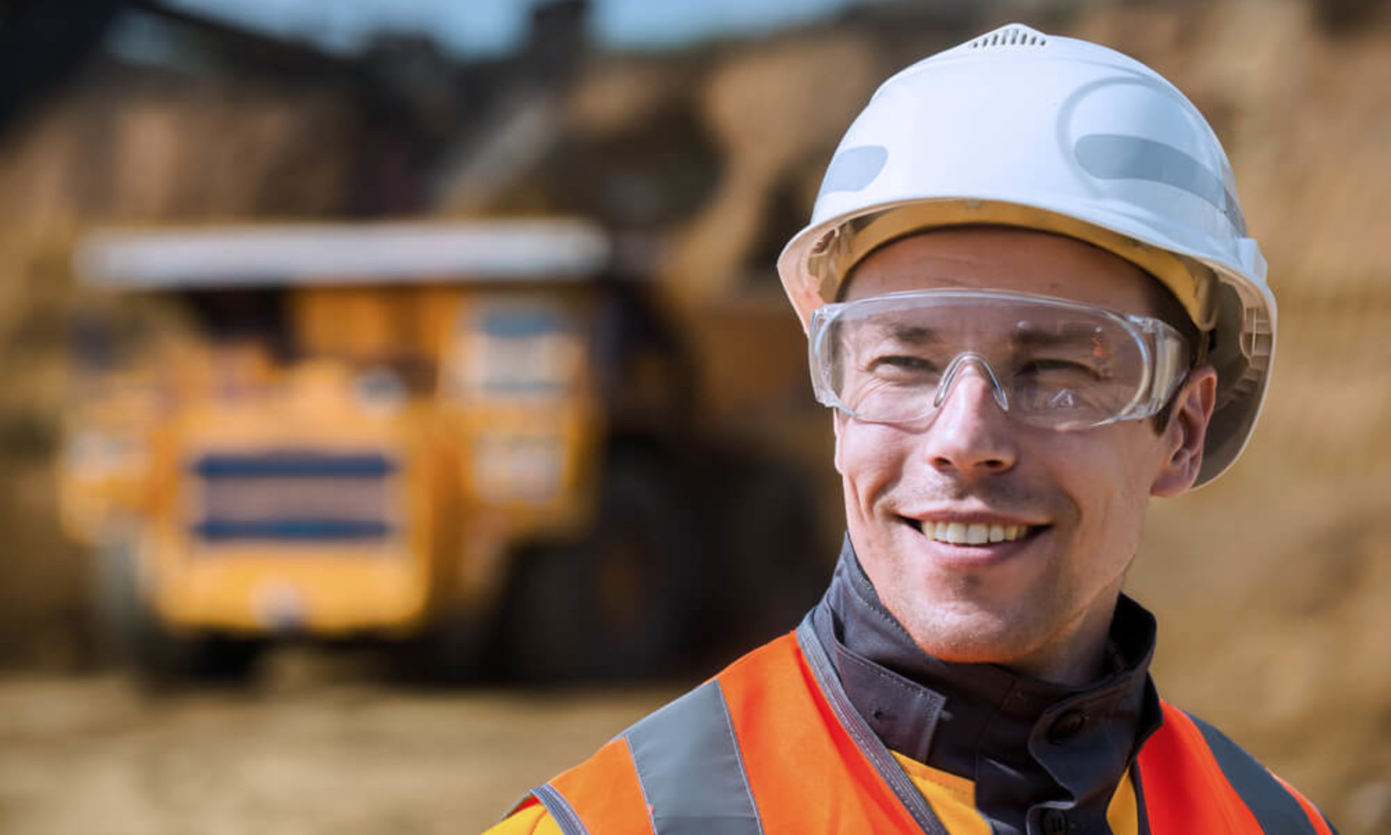 Construction site worker smiling